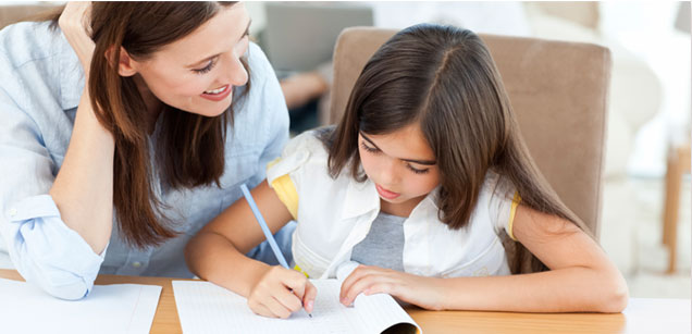 Image of parent helping child study.